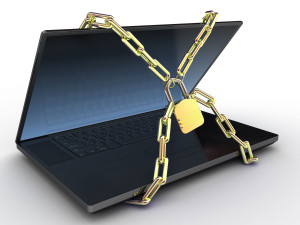 A laptop covered in chains and a padlock