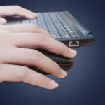 Fingers at a keyboard and mouse to share information