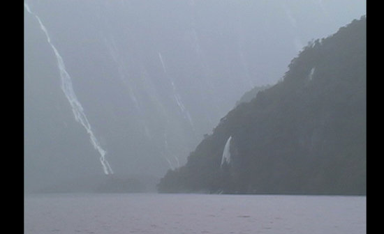 A New Zealand fjord in the rain
