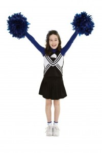 young girl cheerleader with pom poms