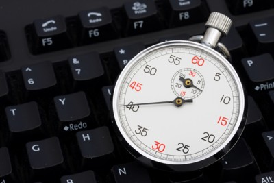 old fashioned stopwatch sitting on a keyboard